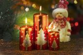 Candles with christmas decorations in atmospheric light — Stock Photo