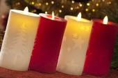 Electric candles with christmas decorations in atmospheric light — Stock Photo