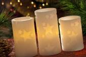 Electric candles with christmas decorations in atmospheric light — Foto de Stock