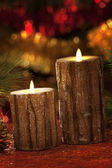 Electric candles with christmas decorations in atmospheric light — ストック写真