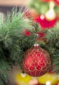 Closeup of red Christmas balls on colored background — Stock Photo