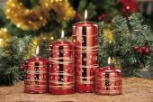 Closeup of colored Christmas candles on colored background — Stock Photo