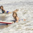 Girls boogie boarding in the ocean waves — Stock Photo #57703859