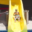 Fun on the water slide at waterpark — Stock Photo #57704877