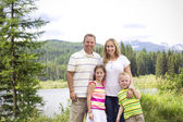 Beautiful Young Family Portrait in the Mountains — Stock Photo