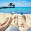 Feet of a couple on lounge chairs — Stock Photo #65752103