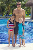 Father with daughter and son at the pool — Stock Photo