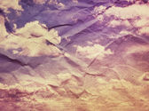 Vintage clouds and sky on crumpled paper texture. — Stock Photo
