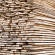 Stack of wood planks for construction buildings and furniture production — Stock Photo #54100699