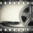 Grunge old motion picture film reel with film strip. Vintage background — Stock Photo #54231453