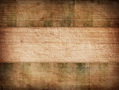 Grunge striped tablecloth on wooden cutting board — Foto Stock