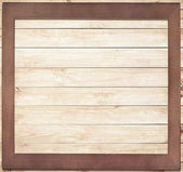 Square wooden frame on wood background — 图库照片