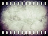 Grunge scratched colorful film strip with stars background — Stock Photo