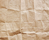 Old crumpled, recycled brown paper texture — Stock Photo