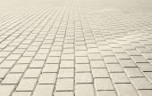Grey brick stone street road. Light sidewalk, pavement texture — Stock Photo