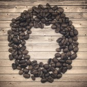 Old brown planks and coffee beans circle. Collage background — Stock Photo