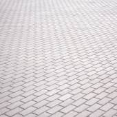 Gray brick stone street road. Light sidewalk, pavement or wall texture — Stock Photo