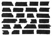 Set of horizontal and different size black sticky tape,adhesive pieces, torn paper on white background.  Can write text, alphabet letters and other symbols. Vector illustration — ストックベクタ