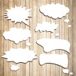 White vector speech bubbles with shadow like clouds on brown wooden wall. Vector Illustration — Stock Vector #78341306