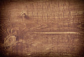 Dark brown scratched wooden cutting board. Wood texture — Stock Photo