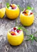 Stuffed lemons with vegetarian salad on the old table — Stock Photo