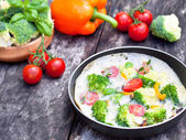 Vegetarian omelette with broccoli cherry tomato orange pepper an — Stock Photo