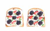 Slices of bread with cream cheese berries and basil isolated on — Stock Photo