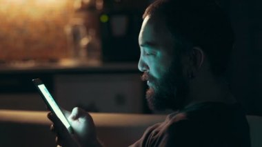 Young man using his smart phone  in the dark — 图库视频影像