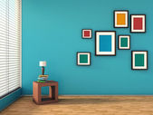 Blue interior with colorful paintings and lamp — Stock Photo