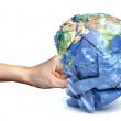 Human hand strikes the planet earth — Stock Photo #69362795