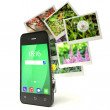 Mobile photography concept: touchscreen smartphone in camera mod — Stock Photo #71153235