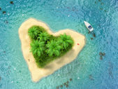 Tropical island with water and palms on a beach in shape of hear — Stock Photo