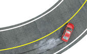 Red car enters the turn with skid. — Stock Photo