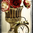 Classic clock  watch in bright colorful retro interior behind red flowers — Stock Photo #61750223