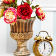 Classic clock  watch in bright colorful retro interior behind red flowers — Stock Photo #61750239