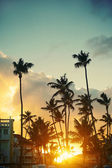 Photo in retro style of beautiful sunset at a beach resort in the tropics — Stock Photo
