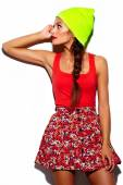 High fashion look.glamor stylish beautiful  young woman model with red lips  in summer bright colorful  hipster cloth in yellow beanie — Stockfoto