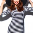 High fashion look.glamor stylish beautiful  young happy smiling woman model with red lips  in zebra dress in black summer hat — Stock Photo #63491783