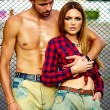 High fashion look.beautiful couple sexy stylish blond young woman model with bright makeup with perfect sunbathed skin and handsome muscled man in vogue style in jeans outdoors — Stock Photo #64671059