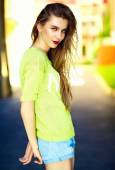 Funny  stylish sexy smiling beautiful young woman model in summer bright hipster cloth dress  in the street — Stock Photo