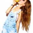 Funny crazy glamor stylish sexy smiling beautiful young blond woman model in summer bright hipster jeans cloth eating hamburger — Stockfoto #76741043