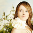 Beautiful young woman and fairytale castle — Stock Photo #56553799