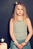 Young blonde girl on birthday party — Stock Photo
