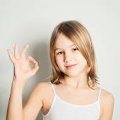 Young girl showing her hand gesture ok — Stock Photo