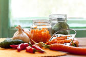 Preparation of organic vegetables in jars — ストック写真