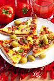 Slice of pizza and fresh tomato juice — Stock Photo