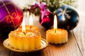 Christmas candles and decorations — Stock Photo