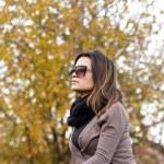 Beautiful girl enjoying autumn day — Stock Photo #60722419
