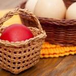 Easter eggs in wicker basket — Stock Photo #68309887