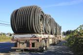 Flexible hose or duct on a double flatbed — Stock Photo